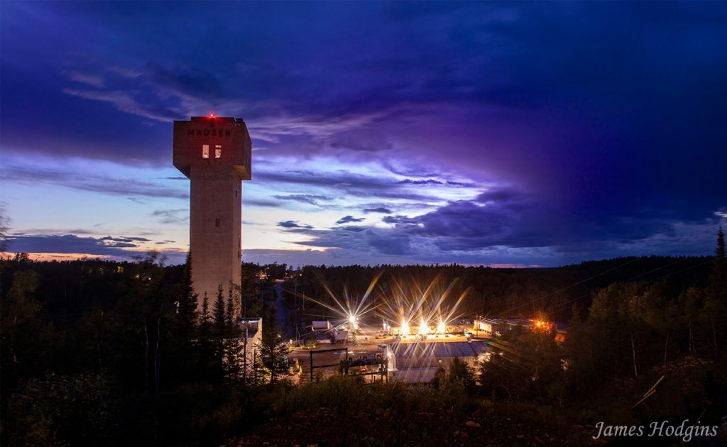 Pure Gold Mining Site at Night by James Hodgins